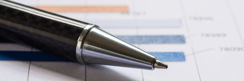 Close-up pen on financial report. Concept of Infomation Data Analysis, Business Investment Analytics and Business Planning. Web stock image