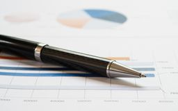 Close-up pen on financial report. Concept of Infomation Data Analysis, Business Investment Analytics and Business Planning. Web royalty free stock photos