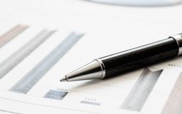 Close-up pen on financial report. Concept of Infomation Data Analysis, Business Investment Analytics and Business Planning. Web stock images
