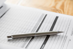 Close up of pen on formal Royalty Free Stock Photography