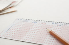 Close up pen on lottery ticket Stock Photos