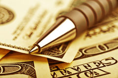 Close-up pen on the money Royalty Free Stock Photo