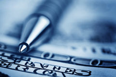 Close-up pen on the money Royalty Free Stock Photos