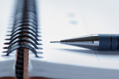 Close up of a pen on a note pad Stock Photos