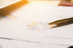 Close up pen on summary report and calculator on table office. Royalty Free Stock Photos