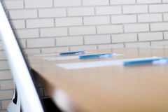 Close up pen on table in empty corporate conference room before business meeting Stock Image