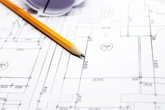 Pencil on drawings with drafts. Close-up with a pencil above drawings with sketches of projects royalty free stock images