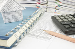 Close up pencil and house on notebook with calculator Royalty Free Stock Images