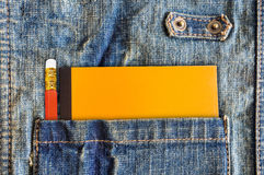 Close-up pencil and note book in pocket of shirt. Royalty Free Stock Images