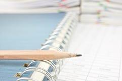 Close up pencil on notebook Stock Photos