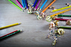 Close up on pencil shred. Color pencils and pencil shred, on wood background Royalty Free Stock Photography