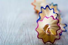 Close up on pencil shred isolated. Macro, close up on pencil shred, on wood background Royalty Free Stock Photo