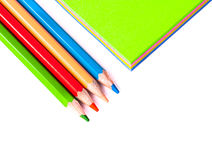Close up of pencils close colorful paper Royalty Free Stock Photos