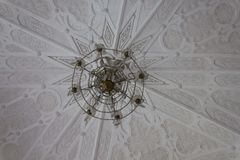 Close up of a pendant lamp and a white ceiling. Stock Photo