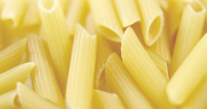 Close-up of penne pasta. On white background stock video