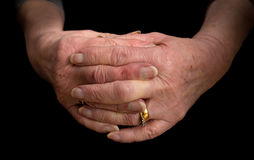 Close up of a pensioners hands with fingers interlaced. Stock Photos