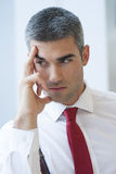 Close-up of pensive Businessman looking off camera Royalty Free Stock Photo