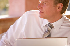 Close up of pensive businessman using laptop Stock Photo