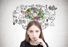 Close up of a pensive teen girl, brain cogs royalty free stock image