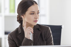 Close up of pensive woman in brown Stock Images