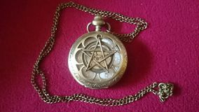Close up from a pentacle pocket watch. Stock Photo