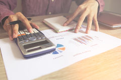 Close up people with calculator counting making. Notes on table, Concept savings finances Royalty Free Stock Images