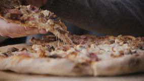 Close-up Of People Hands Taking Slices Pizza from food delivery open box. Tasty Service to office stock video