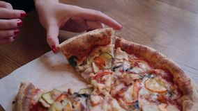Close-up Of People Hands Taking Slices Pizza. Frame. Takes eating a slice of pizza with cheese, tomatoes and ham. Delicious food for gluttony and enjoyment stock footage