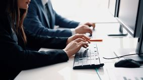 Close up people hands typing on laptop keyboard stock footage