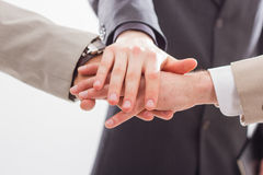 Close up of people that hold hands together. Stock Photos
