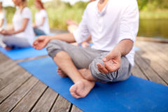 Close up of people making yoga exercises outdoors Stock Photography