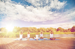 Close up of people making yoga exercises outdoors Stock Images