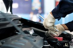 Close up, People are repair a car Use a wrench and a screwdriver to work.  Stock Photos