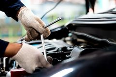 People are repair a car screwdriver to work. Close up, People are repair a car Use a wrench and a screwdriver to work Stock Photos