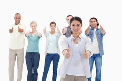 Close-up of people smiling with their thumbs-up. Against white background Royalty Free Stock Image