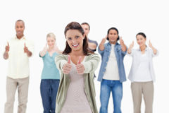 Close-up of people with their thumbs-up. Focus on the women in foreground Royalty Free Stock Photography