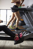 Close Up Of People Using Equipment In Busy Gym Stock Photography