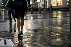 Close up people walking in the city street during heavy rain royalty free stock image