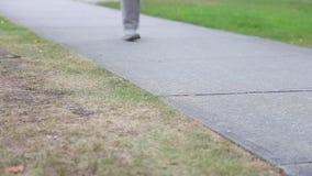 Close up people walking feet stock footage