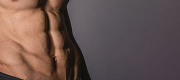 Close up perfect abs. Sexy muscular male torso six packs. Perfect abs Stock Images