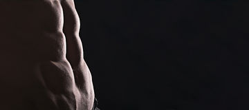 Close up perfect abs. Sexy muscular male torso six packs. Perfect abs Royalty Free Stock Images