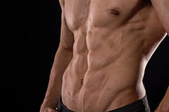 Close up perfect abs. Sexy muscular male torso six packs. Handsome shirtless muscular young man Stock Image