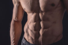 Close up perfect abs. Sexy muscular male torso six packs. Handsome shirtless muscular young man Stock Photo