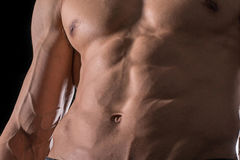 Close up perfect abs. Sexy muscular male torso six packs. Handsome shirtless muscular young man Royalty Free Stock Image