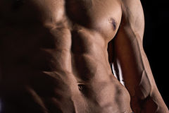 Close up perfect abs. muscular male torso six packs. Handsome shirtless muscular young man Stock Image