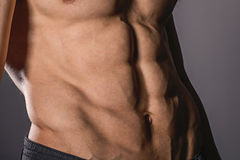 Close up perfect abs. Sexy muscular male torso six packs. Handsome shirtless muscular young man Stock Images