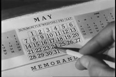 Close-up of person circling date on calendar stock footage