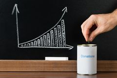 Close-up of a person giving donation Stock Photo