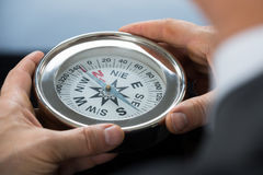 Close-up Of Person Hand With Compass. Close-up Photo Of Person Hand Holding Compass stock photography