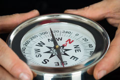 Close-up Of Person Hand With Compass. Close-up Photo Of Person Hand Holding Compass royalty free stock image